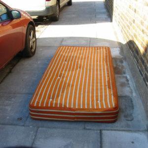 mattress on curb