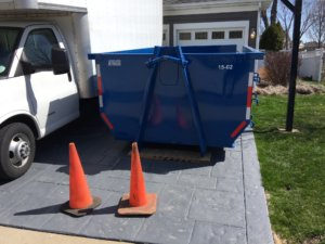 15 yard dumpster rental in client's driveway
